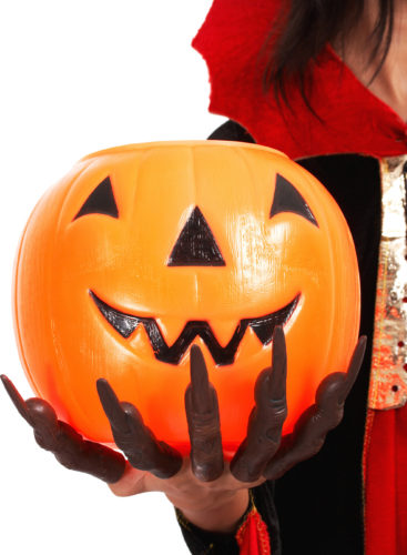 Pumpkin For Trick Or Treat Held By Girl In Vampire Costume